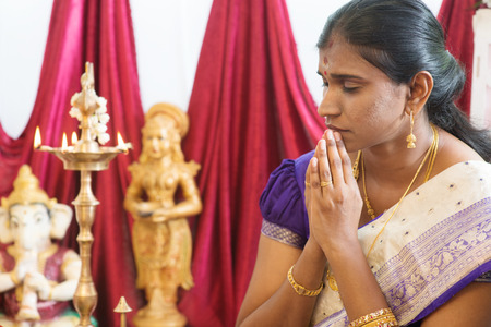 hindus: Woman hand folded during praying events. Traditional Indian Hindus ear piercing ceremony. India special rituals. Stock Photo