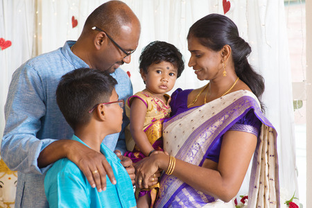 traditional: Traditional India family portrait. Indian parents and children in a blessing ceremony.