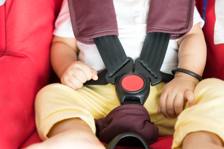 child protection: Close up Asian baby boy sitting in car seat.