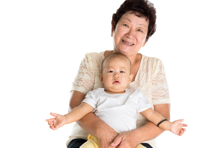 Portrait of Asian grandmother and grandson. Isolated on white background.