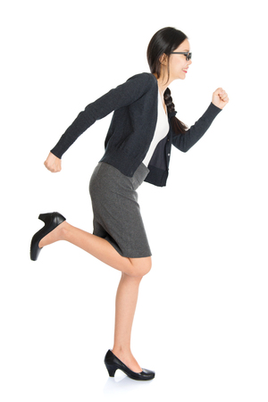 the whole body: Full body portrait of young Asian woman running, isolated on white background. Stock Photo