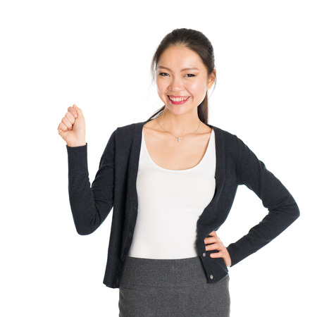 grabbing: Portrait of young Asian woman hand grabbing something and smiling, isolated on white background. Stock Photo