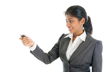 salesgirl: Female Indian car dealer hand over vehicle key to client, isolated on white background.