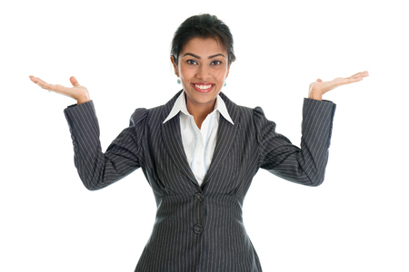 formalwear: Black business woman in formalwear smiling and hands displaying something, isolated on white background. Stock Photo