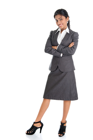 Full length portrait of African American businesswoman standing arms crossed isolated on white background. Stock Photo