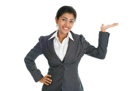 formalwear: Black business woman in formalwear smiling and hand showing something, isolated on white background.