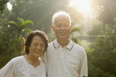 Portrait of healthy Asian seniors retiree couple having activities at outdoor nature park, morning beautiful sunlight background. photo
