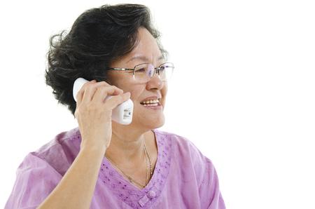 senior adult woman: Portrait of Asian senior adult woman calling on telephone, isolated on white background.