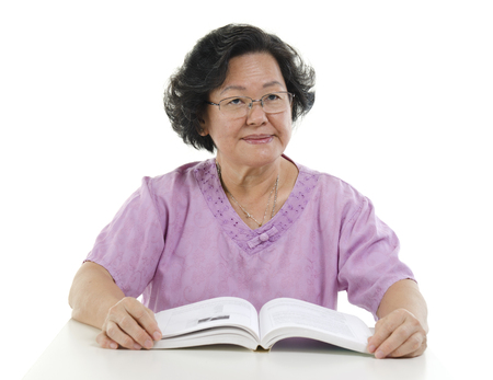 senior adult woman: Wisdom Asian senior adult woman reading book, isolated on white background.