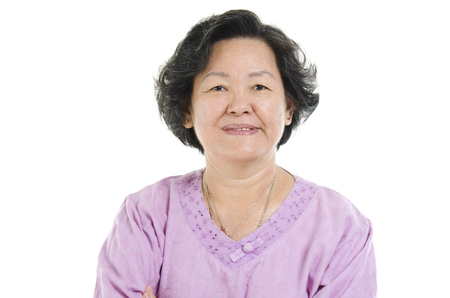 senior adult woman: Portrait of 60s Asian senior adult woman smiling, isolated on white background.