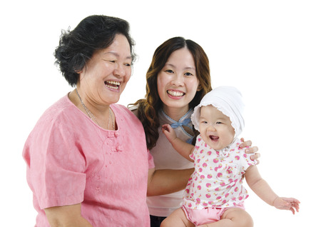Portrait of happy three generations Asian family, senior woman, adult daughter and baby girl, isolated on white background. photo