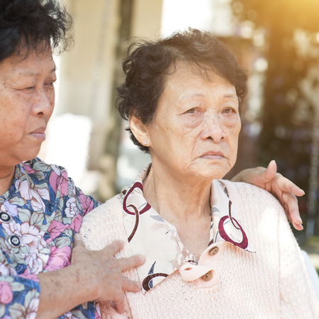 Candid shot of Asian elderly women chit chatting at outdoor park in the morning. Stock Photo
