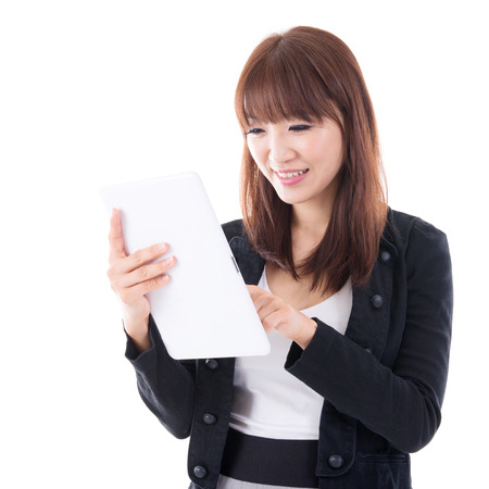 Young Asian female using digital computer tablet, isolated on white background. photo