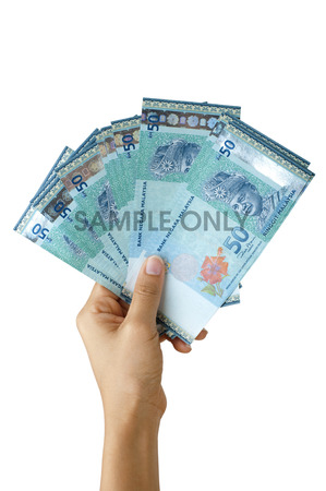 Malaysian currency, hand holding hundreds ringgit Malaysia, isolated on white background.
