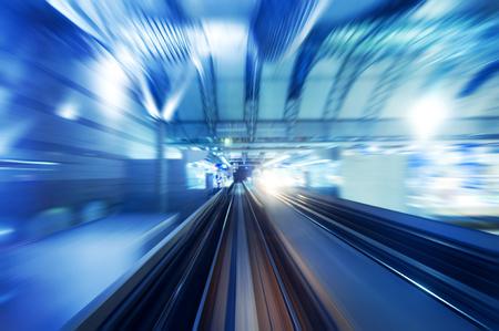 night vision: High speed train entering station platform. Focus on the rail road.
