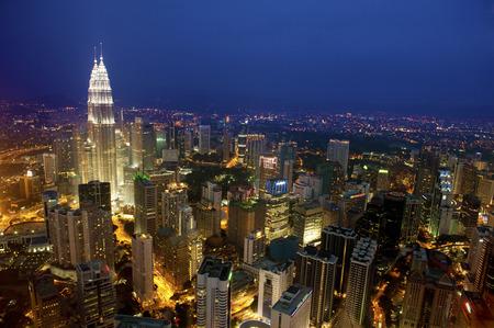 Sunset Aerial View with blue sky of Kuala Lumpur skyline, capital city Malaysia.