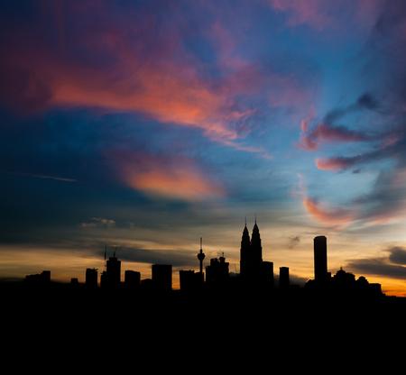 Silhouette Kuala Lumpur city skyline in twilight.