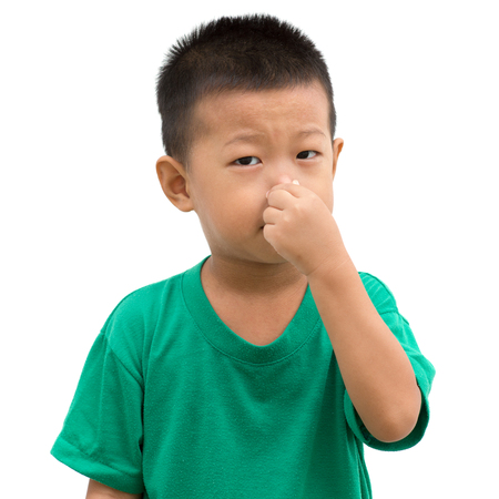 Asian child pinching his nose. Portrait of young boy isolated on white background.