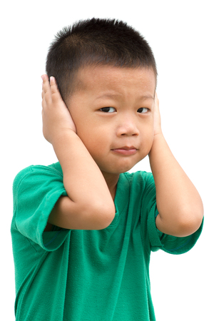 Asian child covering his ears. Portrait of young boy isolated on white background.