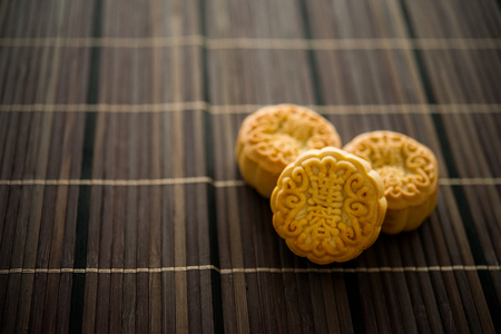 Traditional mooncakes is offered to friends or family during Mid-Autumn Festival. The Chinese character on the moon cake represent
