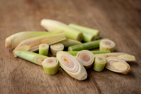 Fresh green lemongrass slices on wooden background. Stock Photo