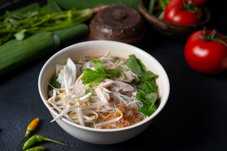 Indonesian chicken and rice noodle soup. Stock Photo