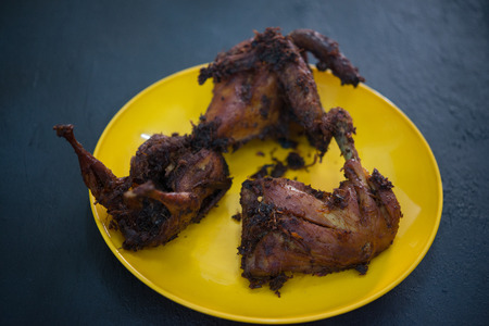 Traditional Malay style fried chicken with spices.