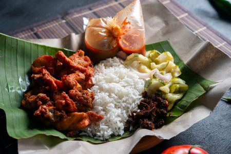 Nasi kukus ayam berempah, popular traditional Malay local food. Фото со стока