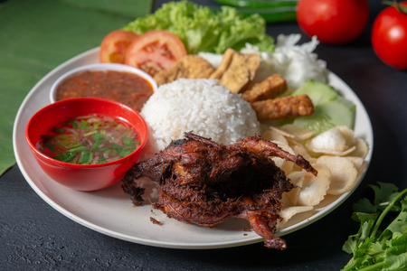 Nasi lemak kukus with quail meat, popular traditional Malaysian local food. Zdjęcie Seryjne