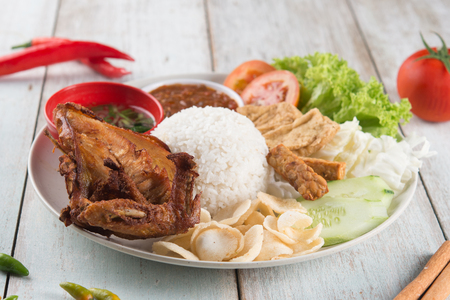 Nasi lemak kukus with fried chicken, popular traditional Malaysian local food.