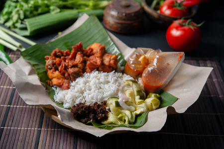 Nasi kukus ayam berempah, popular traditional Malay local food. Banco de Imagens