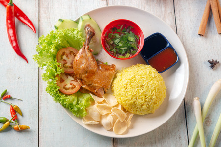 Chicken rice with drumstick, popular traditional Malaysian local food. Flat lay top down overhead view.