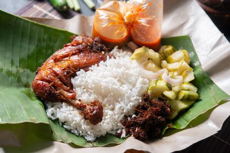 Nasi lemak kukus with chicken, popular traditional Malay local food.