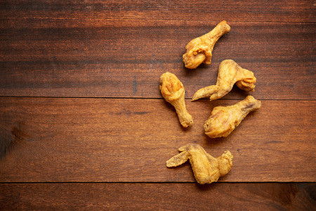 Top view flat lay original recipe fried chickens with copy space, on dark wooden background. Stok Fotoğraf