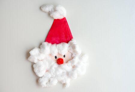 Child artwork, handmade Santa Claus on white background.