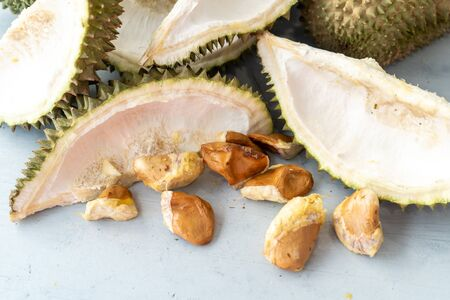 Leftover durian, shells and seeds on table.