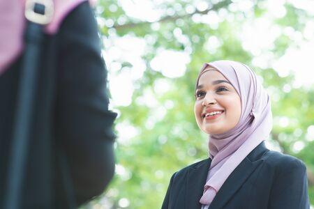 Beautiful Muslim business woman talking and smile. Imagens
