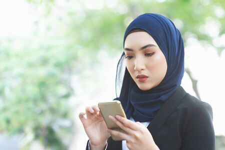 Woman looking at mobile phone with serious face, negative emotion, phishing scams concept.