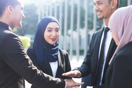 Multiracial business people stacking hands, businessman and businesswoman teamwork concept. Imagens