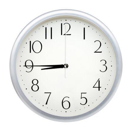 Analog wall clock isolated on white background. Imagens