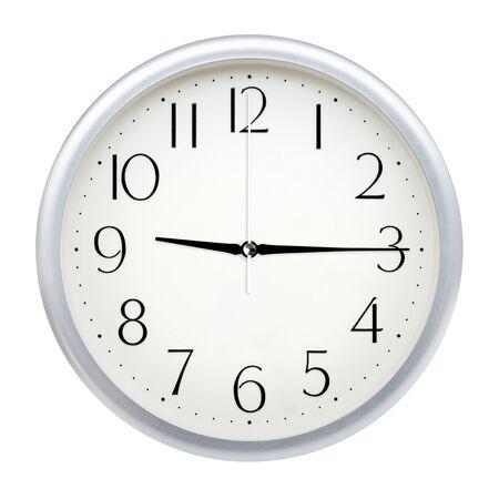 Analog wall clock isolated on white background. Stock Photo