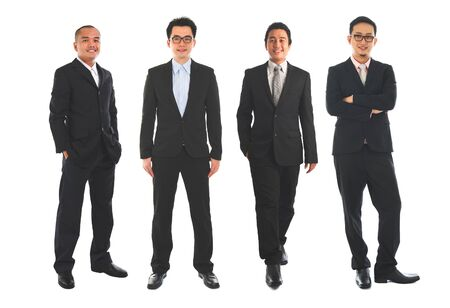 Full length Asian business man standing isolated on white background. Foto de archivo