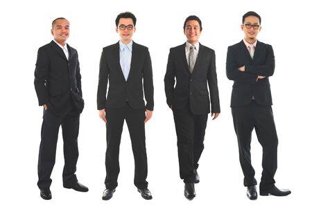 Asiatische Geschäftsmannstellung in voller Länge lokalisiert auf weißem Hintergrund. Standard-Bild