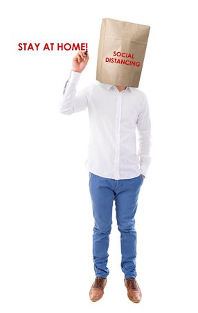 Social distancing to avoid the spread of coronavirus. Man covered head with paper bag. Standard-Bild