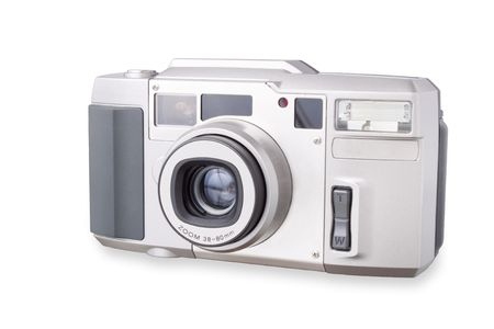 photo of accessories: The old analog camera with a retractable lens. The popular former design. Stock Photo