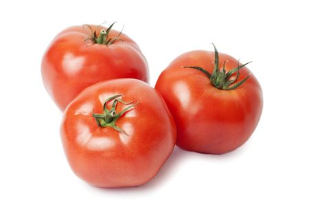 Three juicy, red tomatoes isolated on white background Stock Photo - 7729970