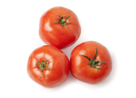 royalty free: Three juicy, red tomatoes isolated on white background