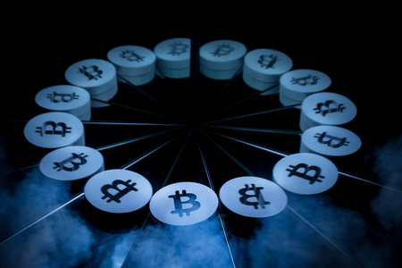 Bitcoin Currency Symbol Covered In Dark Winter Fog With many Mirror Reflections of Itself