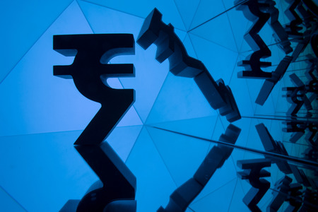 Indian Rupee Currency Symbol With Many Mirroring Images of Itself on Blue Background Banco de Imagens