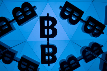 Bitcoin Currency Symbol With Many Mirroring Images of Itself on Blue Background